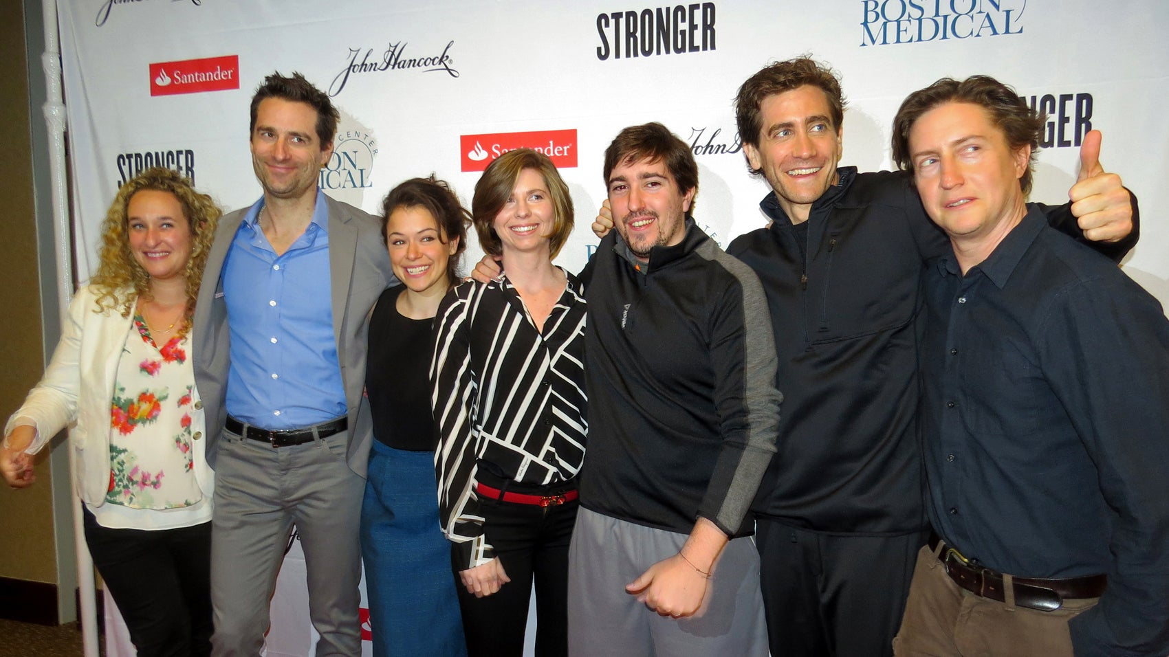 Cast and crew of Stronger pose on the red carpet before BMC's 2016 Marathon pasta dinner.