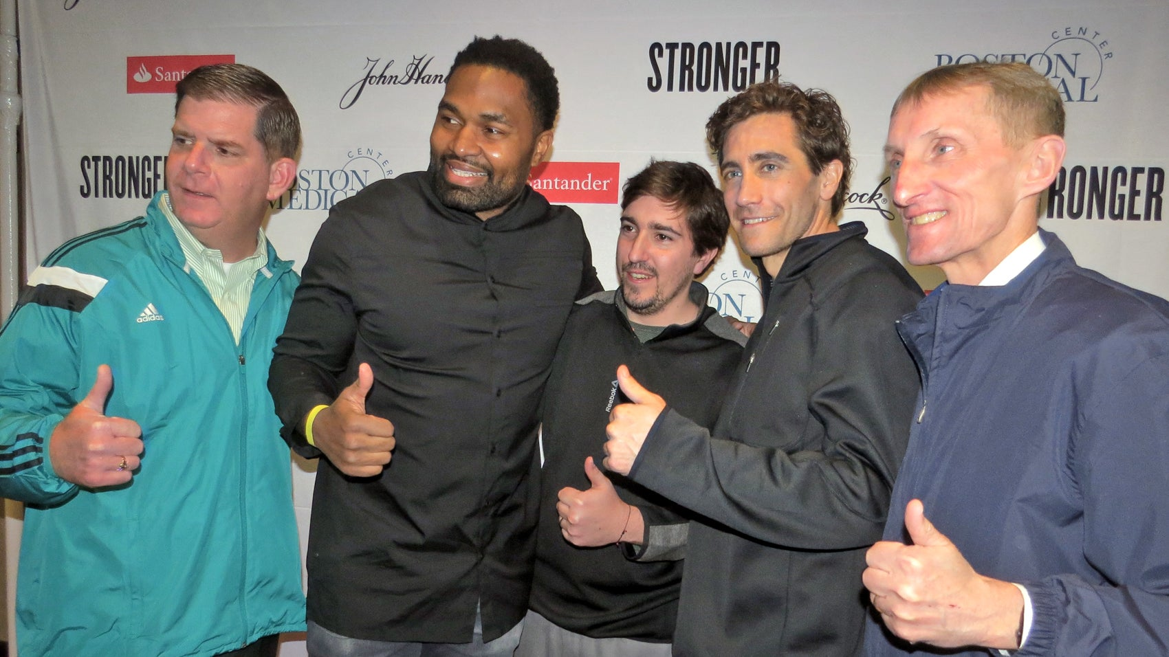 From left: Mayor Marty Walsh, retired New England Patriots player Jerod Mayo, Jeff Bauman, and Jake Gyllenhaal