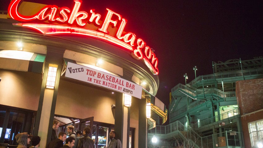 People enter the Cask 'n Flagon bar outside Fenway Park in the Fenway neighborhood of Boston, Dec. 5, 2015.
