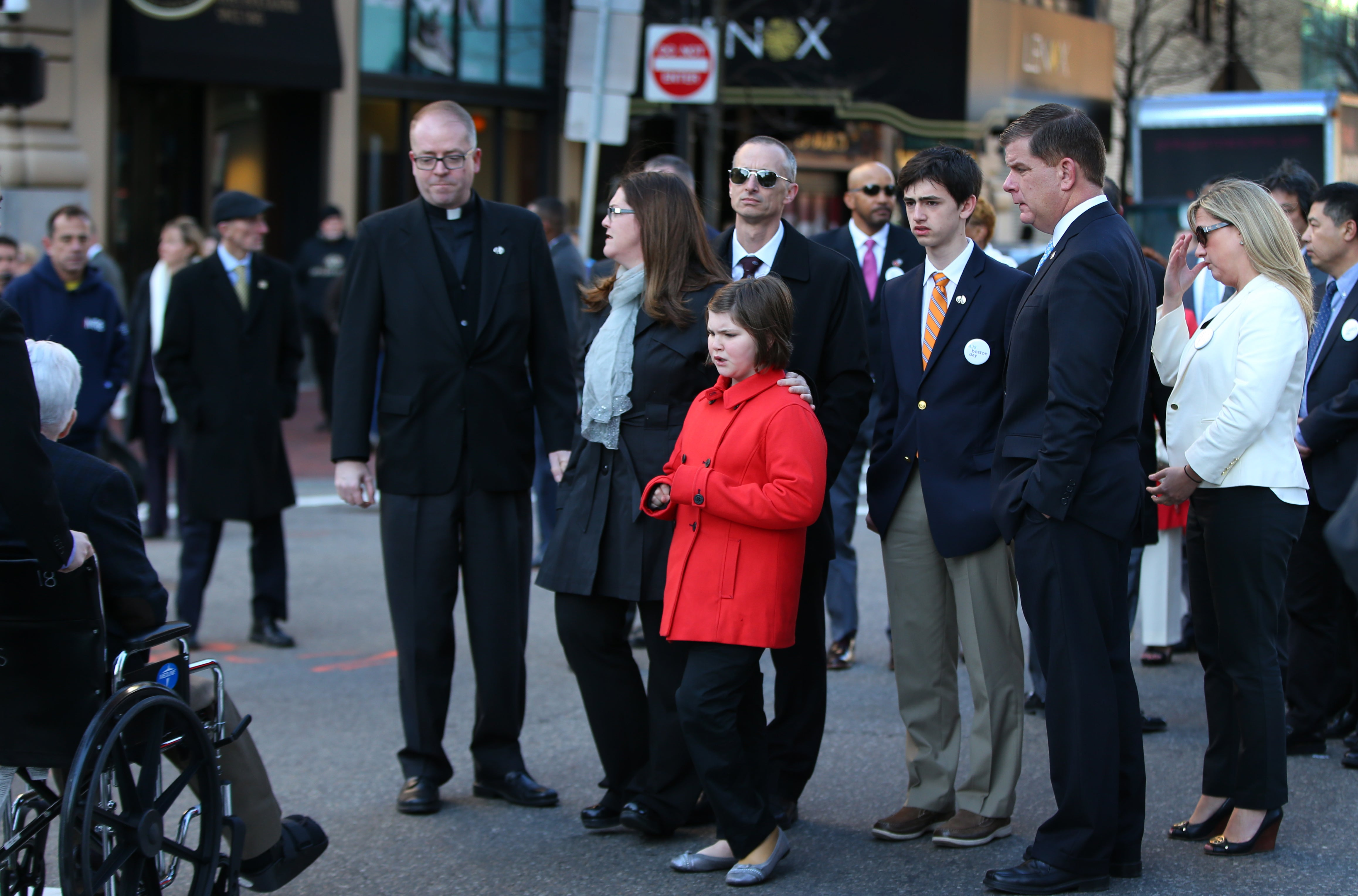04152016 Boston Ma Boston Mayor Marty Walsh with the Richards famity and others after a Wreath Laying ceremony on Boylston Street to honor Marathon Bombing victims. THeir were two ceremonies one with the Governor and one with the Mayor .Boston Globe/Staff Photographer Jonathan Wiggs