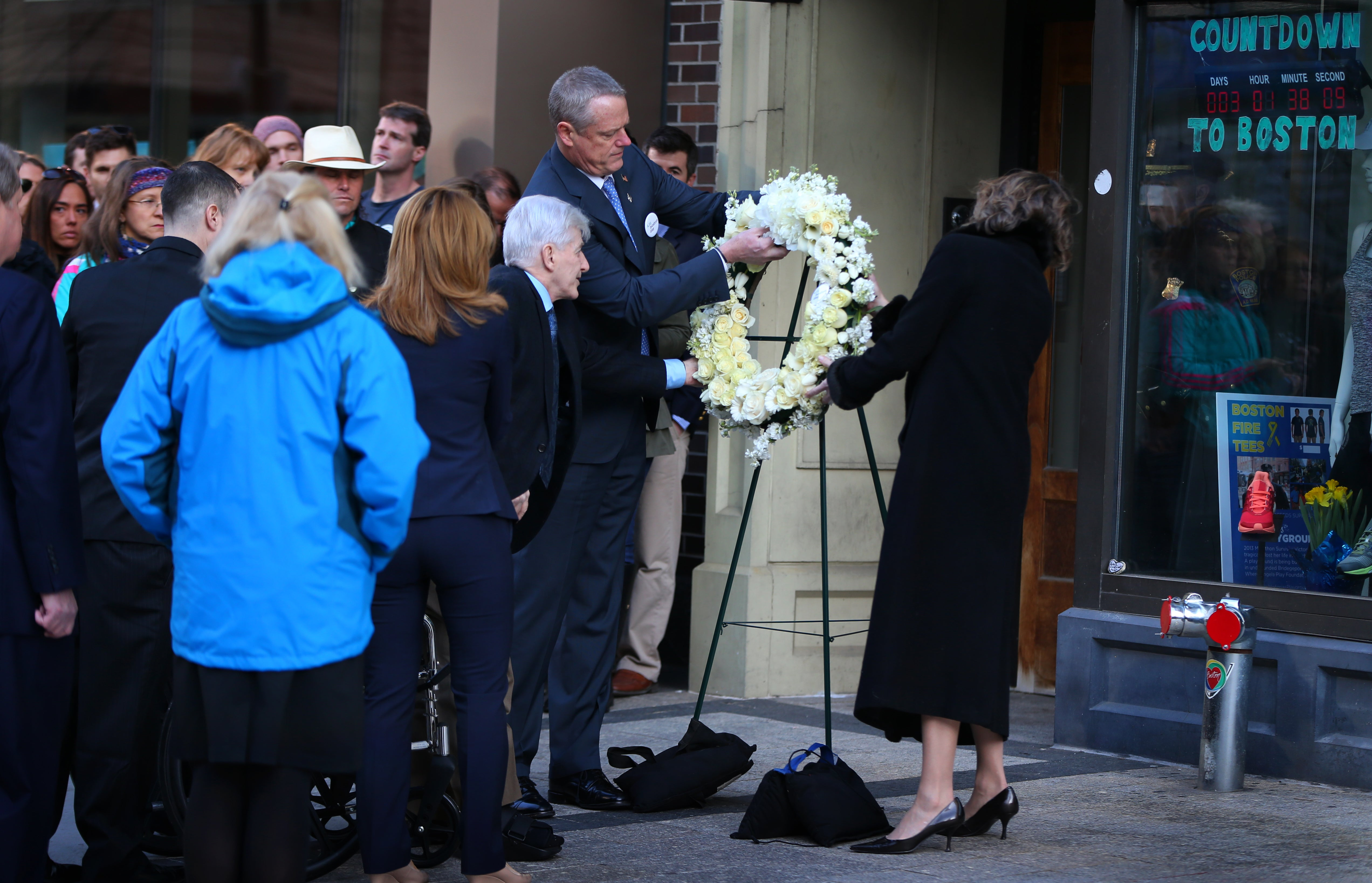 04152016 Boston Ma Governor Charlie Baker and his wife during Wreath Laying ceremoney on Boylston Street with members of the Cambpell Family to honor Marathon Bombing victims. .Boston Globe/Staff Photographer Jonathan Wiggs