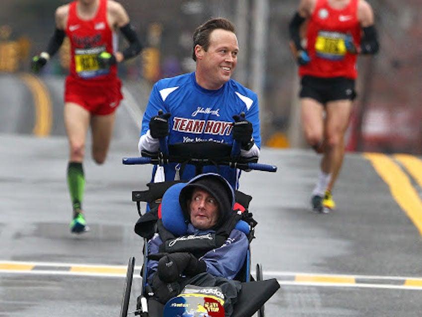 Hopkinton to Boston, MA--4/20/2015--Team Hoyt in Mile 8 in Natick. The 119th Boston Marathon is run on Monday, April 20, 2015. Photo by Pat Greenhouse/Globe StaffTopic: Race coverageReporter: XXX
