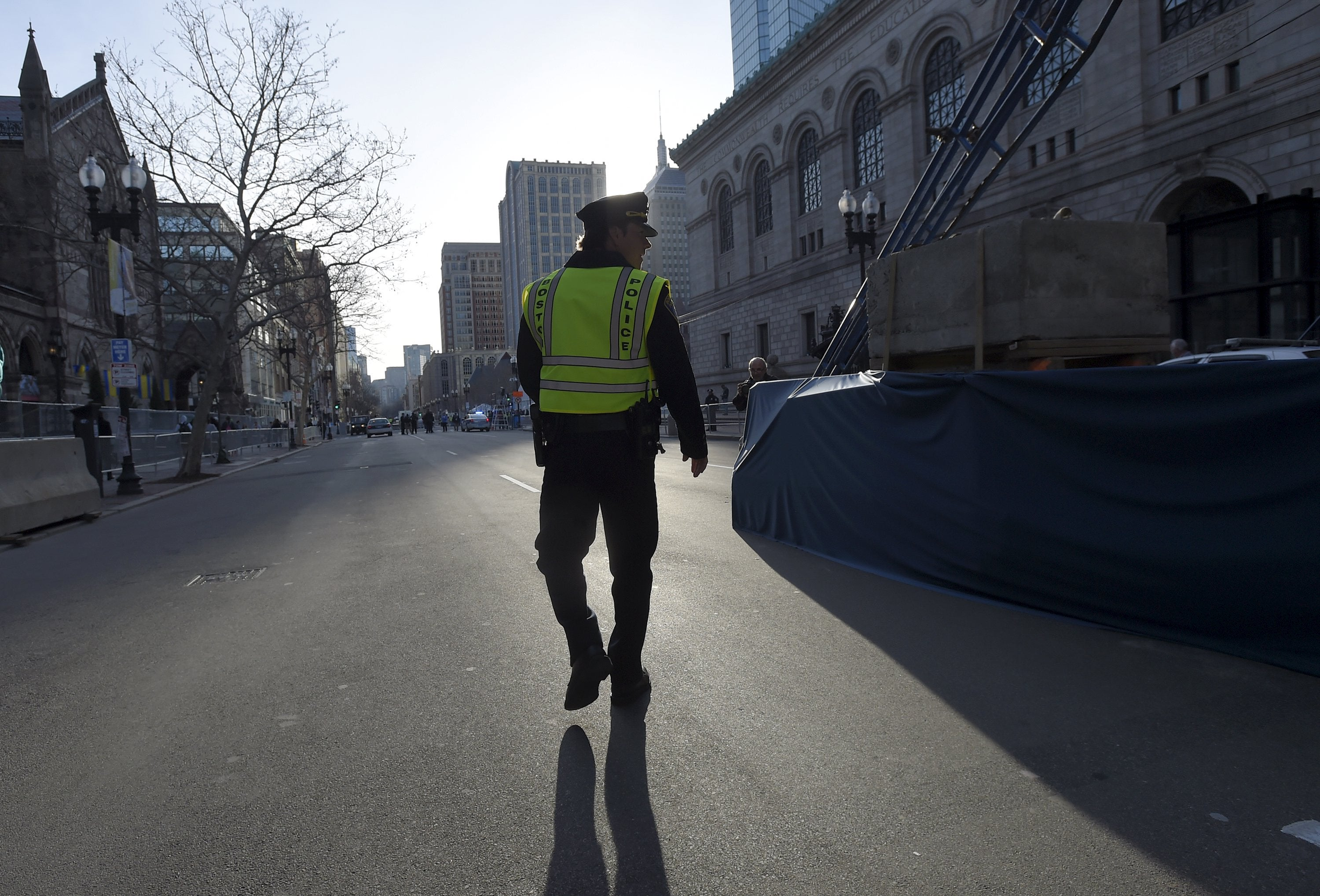 """Actor Mark Wahlberg in the role of a Boston police officer prepares to film a scene for the movie """"Patriot's Day"""" at the finish line before the start of the 120th running of the Boston Marathon in Boston, Massachusetts April 18, 2016."""