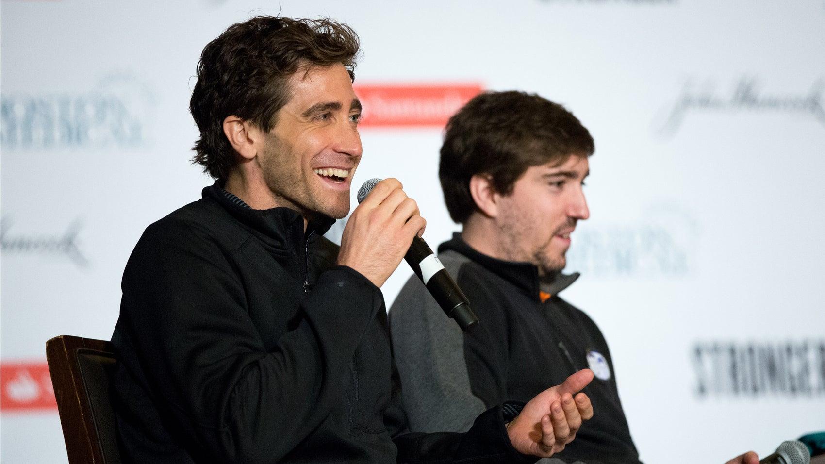 Gyllenhaal and Bauman speak on stage at the pasta dinner.