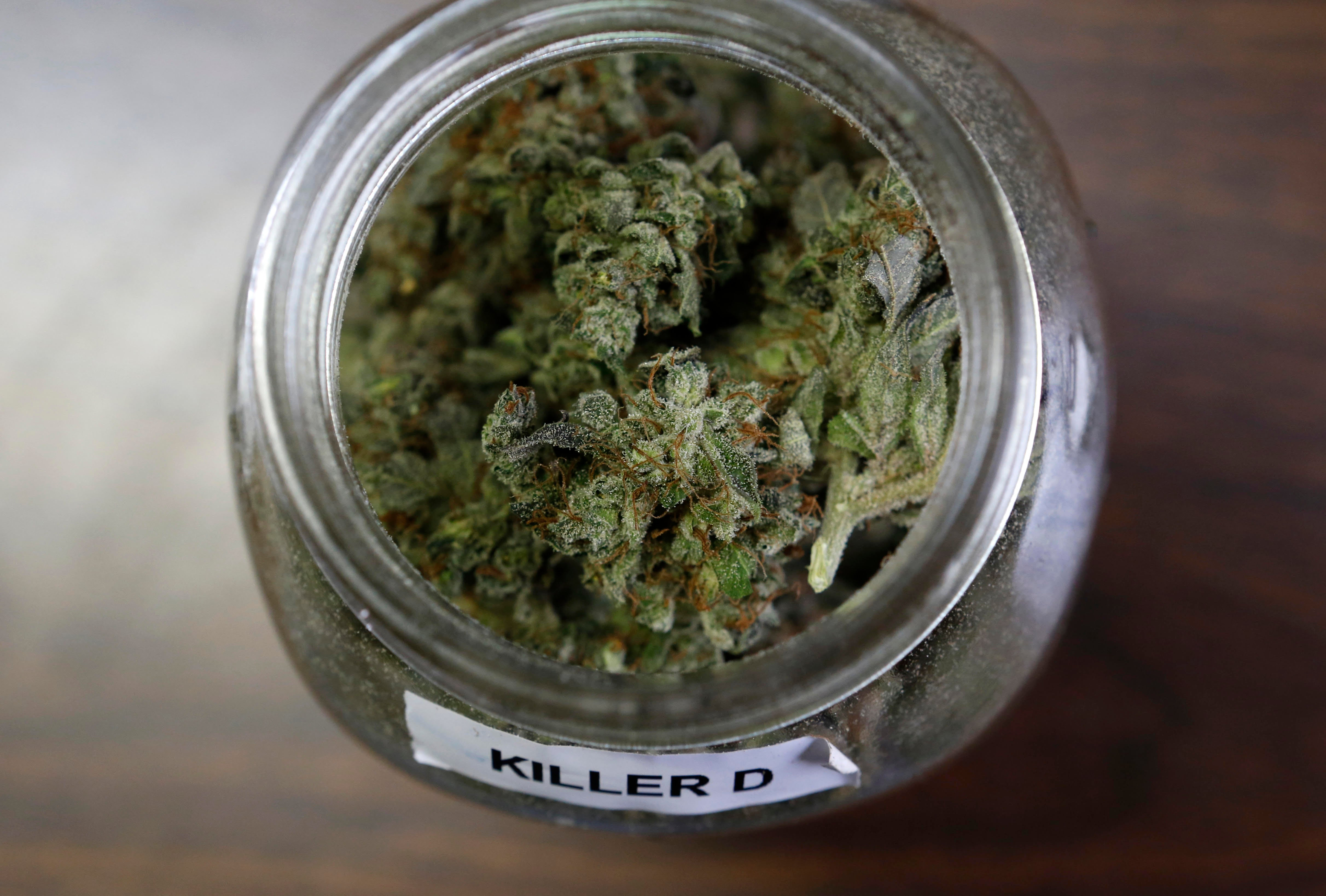 """In this Friday, April 22, 2016 photo, a jar containing a strain of marijuana nicknamed """"Killer D"""" is seen at a medical marijuana facility in Unity, Maine. A growing number of health experts and law enforcement officials are making the case that marijuana could help reduce the numbers of overdoses and redirect money into fighting heroin and other opiates. (AP Photo/Robert F. Bukaty)"""