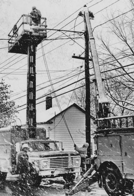 An electric crew in Pittsfield repairs an outage on the morning of May 9, 1977.