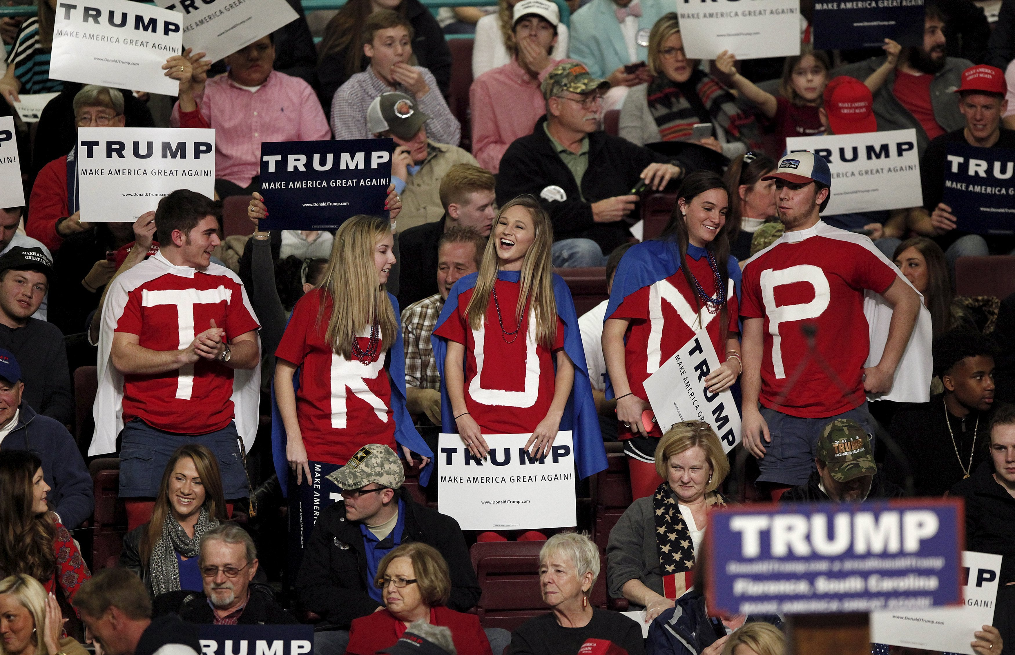 Students from Hartsville High School in Hartsville, South Carolina dressed as caped crusaders for Republican presidential candidate Donald TrumpTrump, cheer for Trump at the Florence Civic Center in Florence, South Carolina, February 5, 2016. REUTERS/Randall Hill