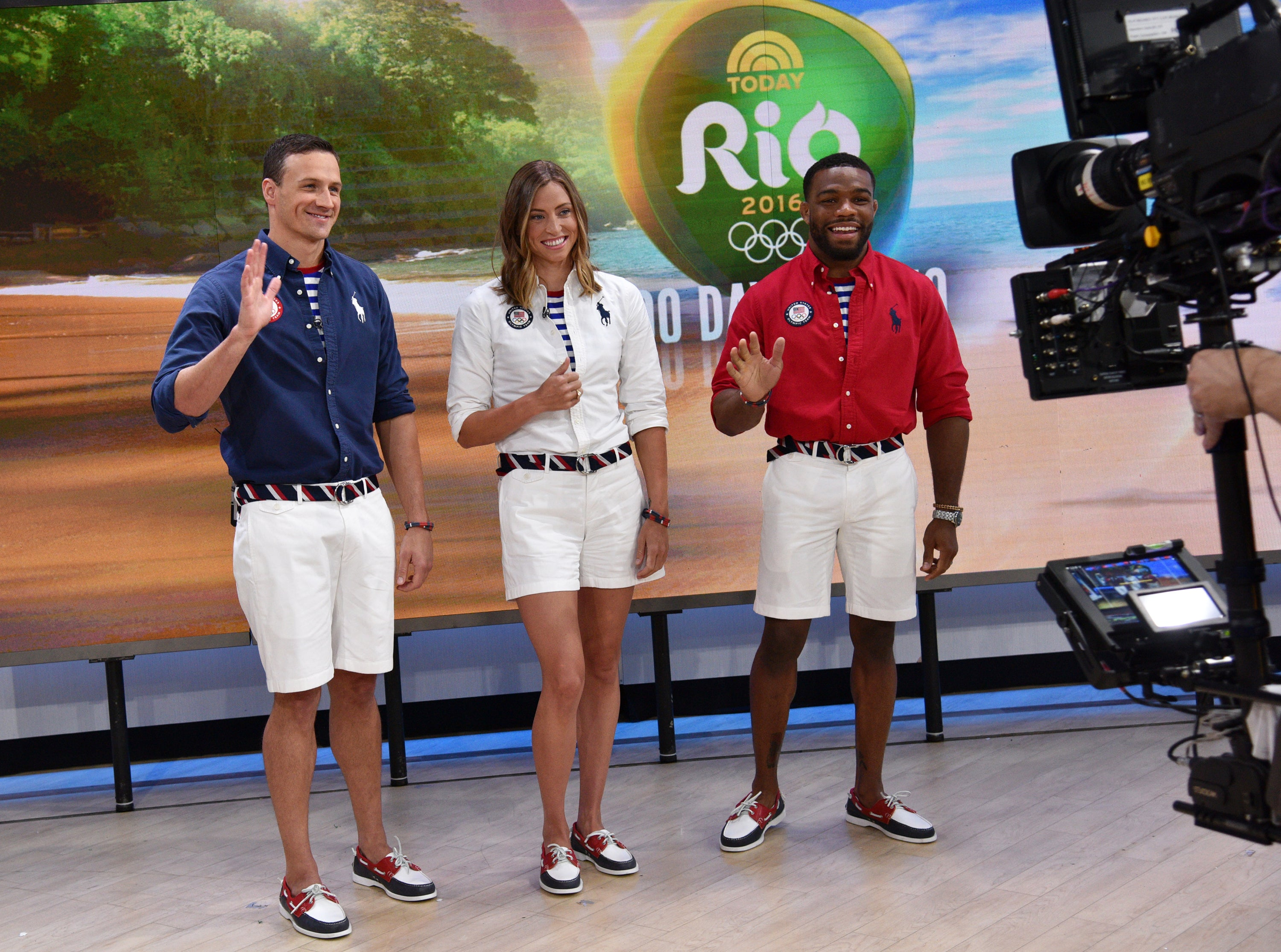 """In this image released by NBC, U.S. Olympic athletes, from left, Ryan Lochte, Haley Anderson and Jordan Burroughs, model Polo Ralph Lauren closing ceremony uniforms on the """"Today Show"""" in New York, Wednesday, April 27, 2016. (Photo by: Bryan Bedder/NBC)"""