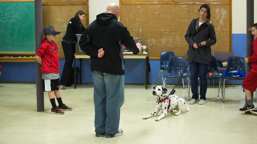 """Kelli Learned and her husband Brian brought their children and Dalmatian puppy Mighty to Coughlin's class. """"He's very high energy,"""" Kelli said. """"But we heard great things about Francine."""""""