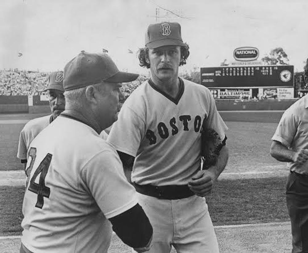 Bill Campbell shakes manager Don Zimmer's hand after what was probably another 70-pitch relief outing in 1977.