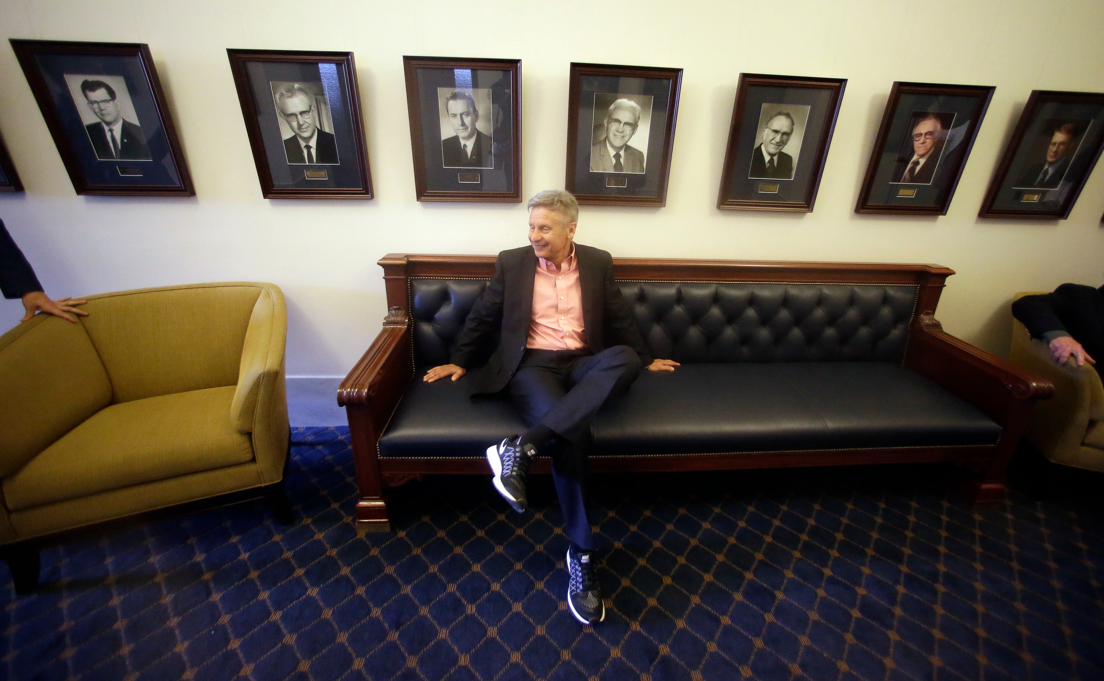 Libertarian candidate and former New Mexico Gov. Gary Johnson waits to speak with legislators at the Utah State Capitol Wednesday, May 18, 2016, in Salt Lake City. Seizing new fuel for his appeal to Donald Trump's critics, Johnson has joined forces with another former Republican governor to strengthen his Libertarian presidential bid. William Weld, who served two terms as the Republican governor of Massachusetts in the 1990s, will announce plans Thursday to seek the Libertarian Party's vice presidential nomination, Johnson confirmed in a Wednesday interview with the Associated Press. (AP Photo/Rick Bowmer)