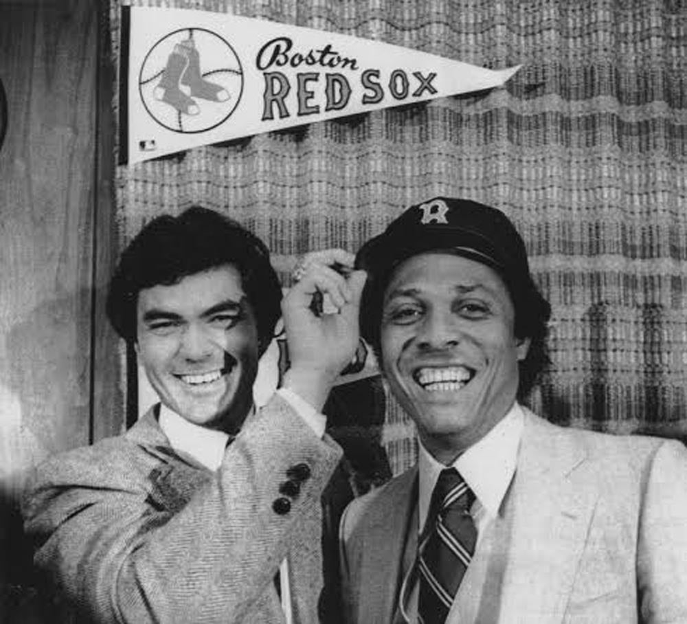 Tony Perez hams it up with new teammate Dwight Evans after signing a free-agent contract with the Red Sox before the 1980 season.