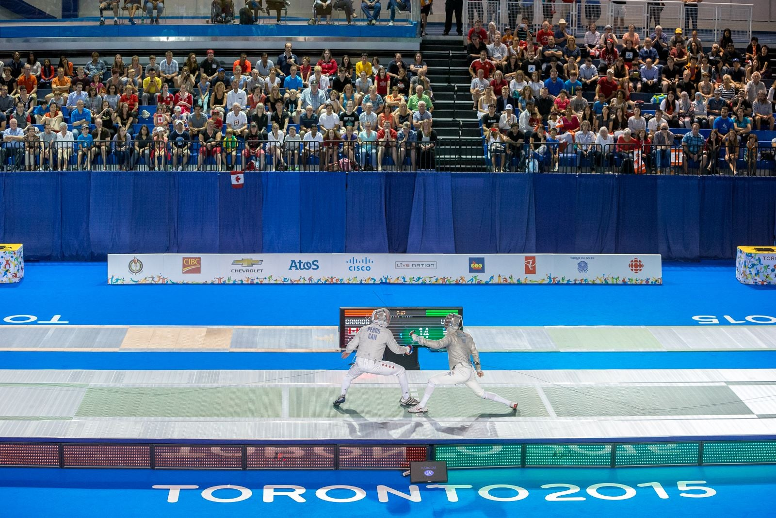 Eli Dershwitz, right, fences in the Pan American Games in Toronto in 2015.