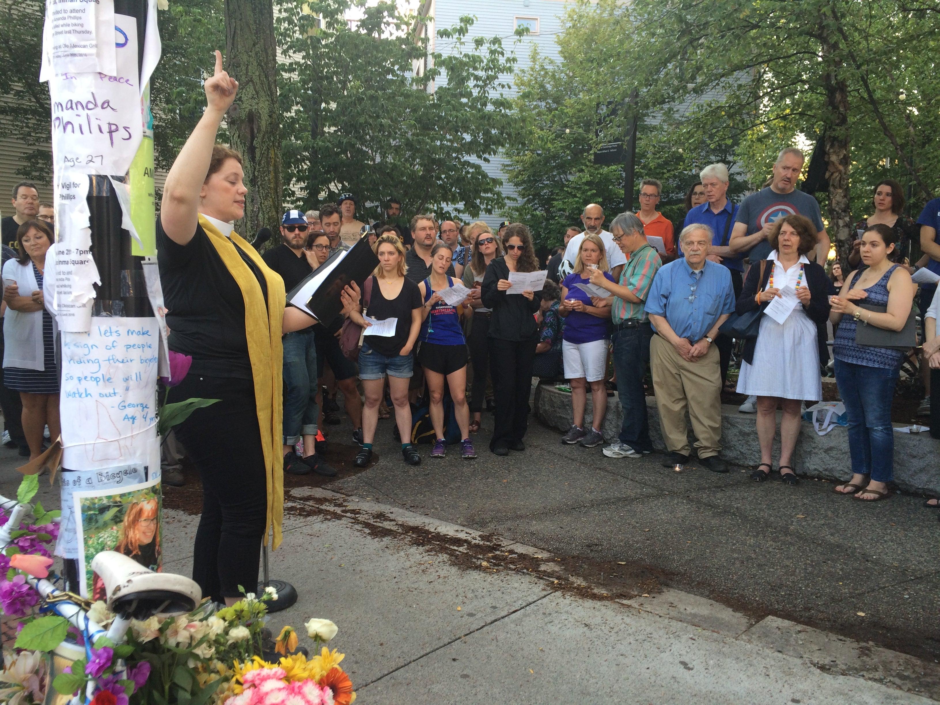 Laura Everrett leads the memorial service for Amanda Phillips.