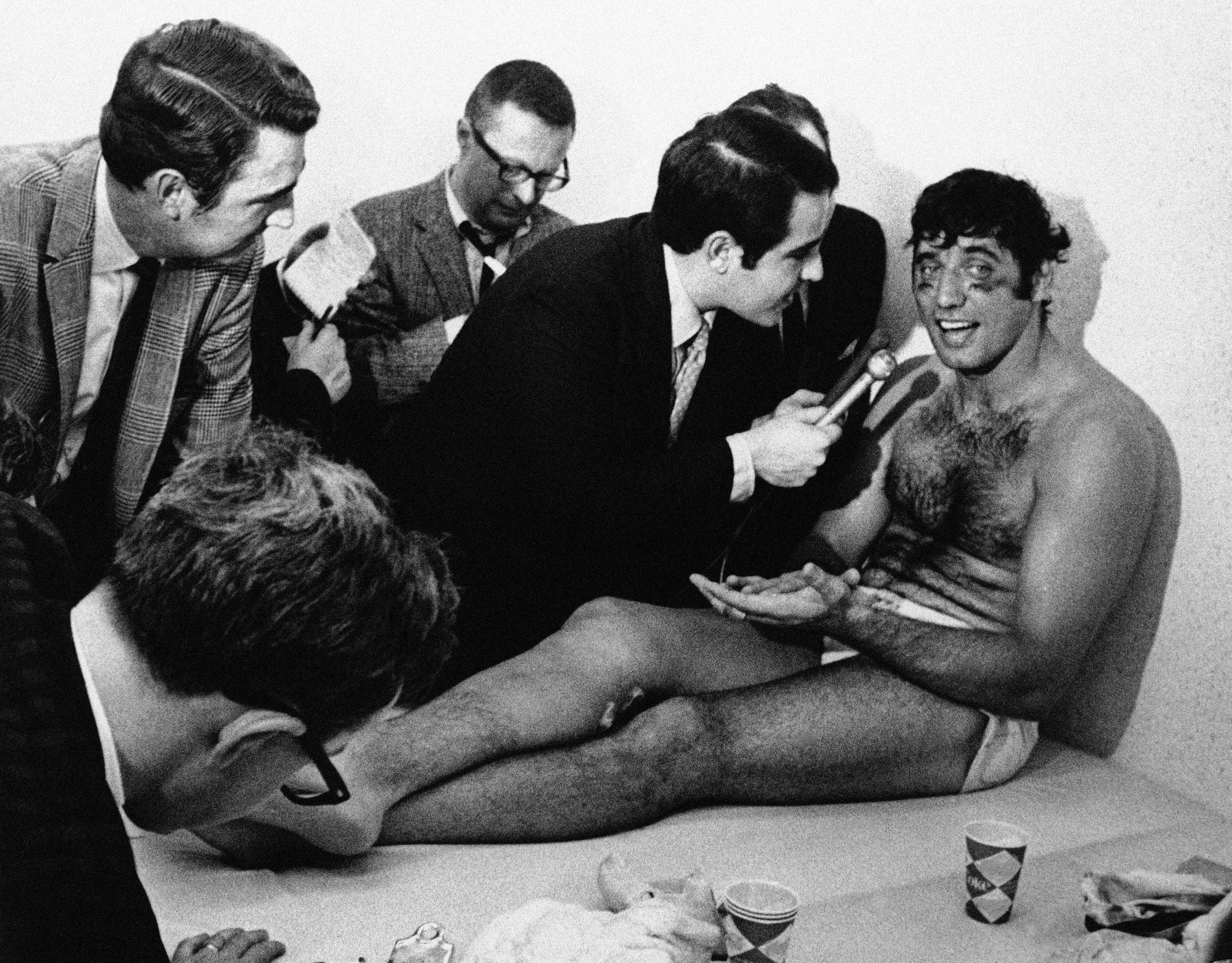 New York Jets quarterback Joe Namath talks with reporters after the Jets defeated the Baltimore Colts 16-7 in Super Bowl III.