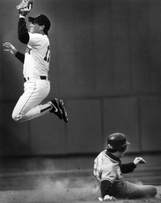 Jim Eisenreich slid in safely after stealing second base in a game against the Red Sox.