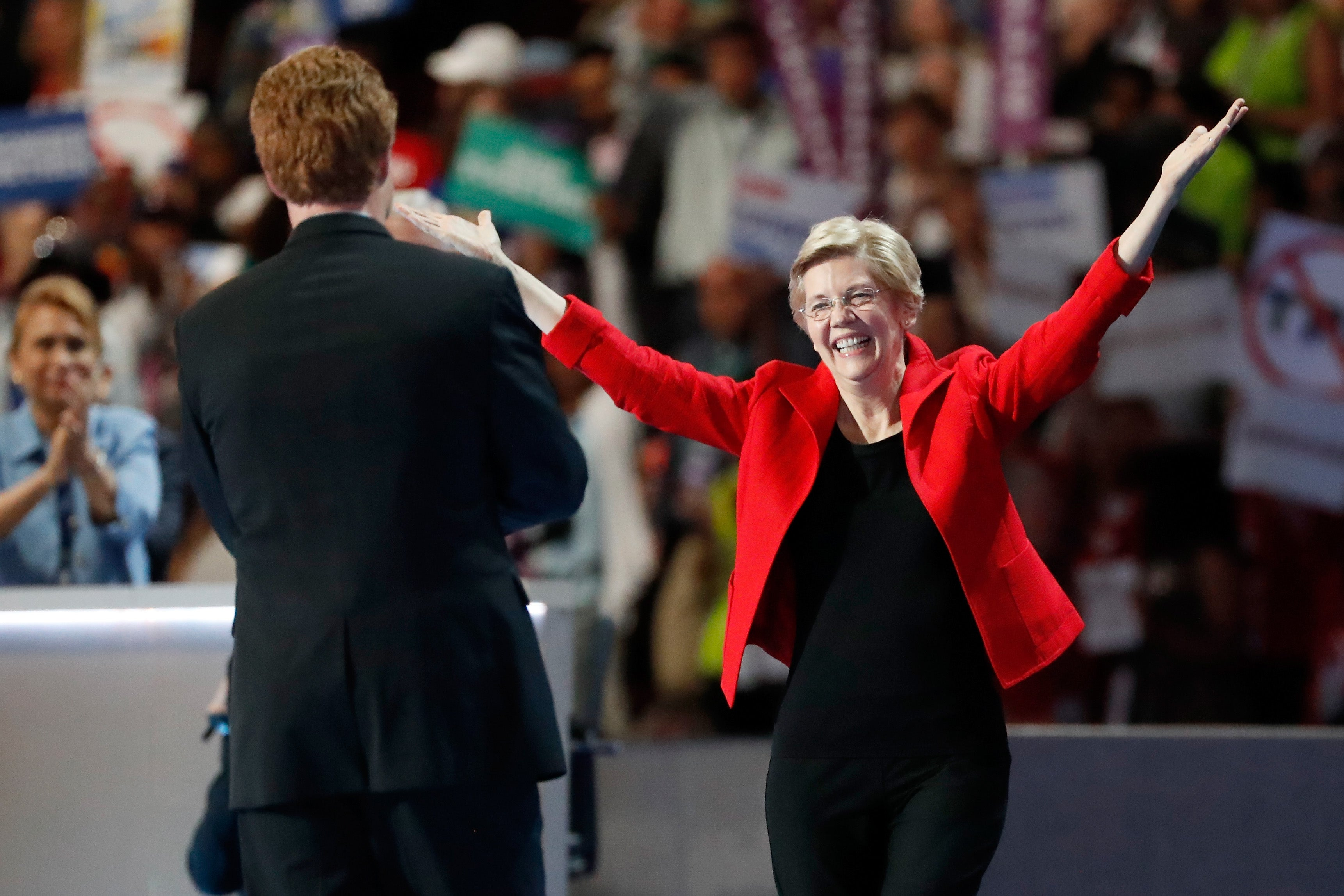 PHILADELPHIA, PA - JULY 25: Sen. Elizabeth Warren (D-MA) gestures after being introduced by Rep. Joseph P. Kennedy, III (D-MA) (L) on the first day of the Democratic National Convention at the Wells Fargo Center, July 25, 2016 in Philadelphia, Pennsylvania. An estimated 50,000 people are expected in Philadelphia, including hundreds of protesters and members of the media. The four-day Democratic National Convention kicked off July 25. (Photo by Aaron P. Bernstein/Getty Images)