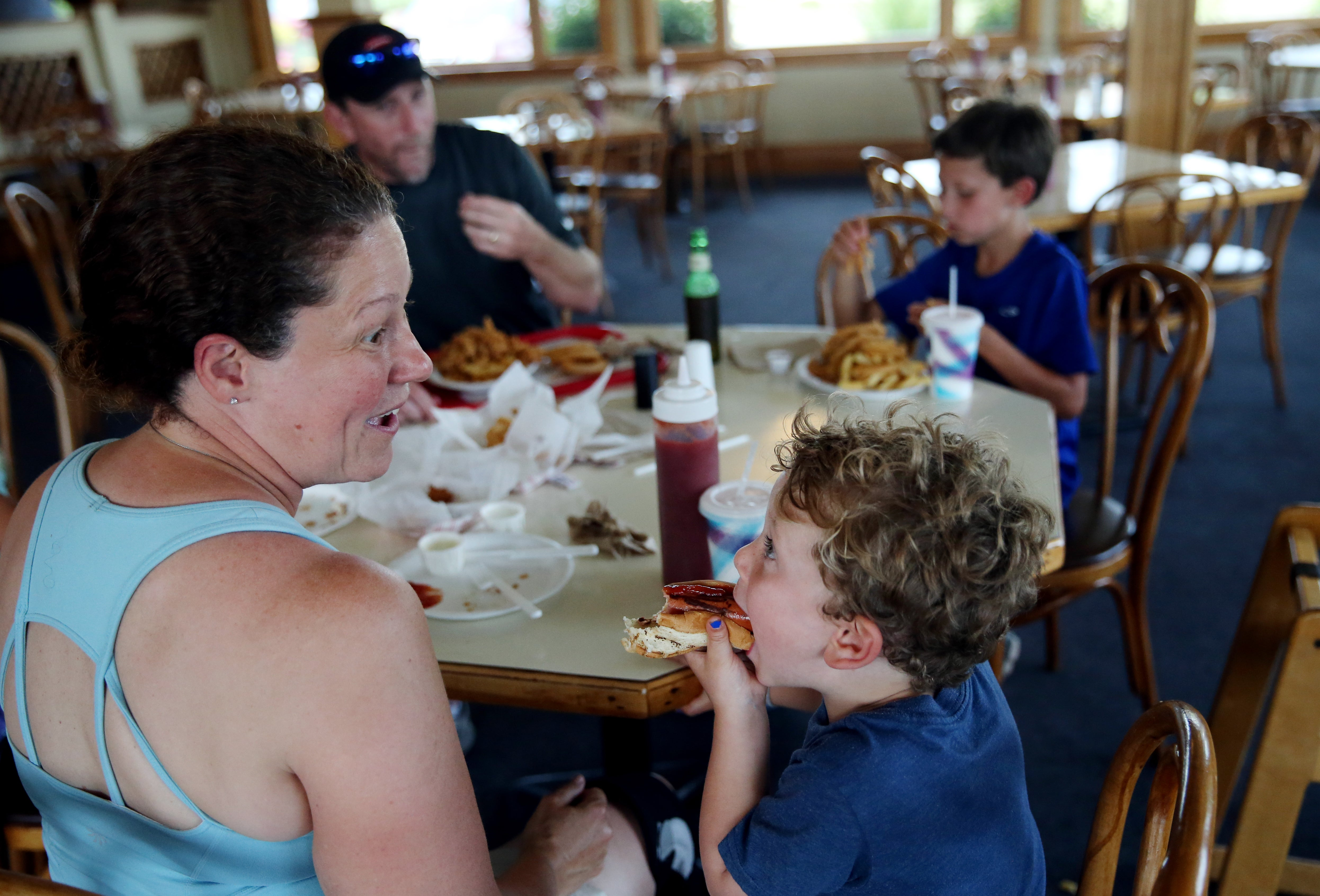 08/26/2015 Dennis, MA – Beth Boulay (cq) jokes with her son Ryan, 4, (cq) while having lunch with their family at Kream 'N Kone in West Dennis, MA on August 26, 2015. (Craig F. Walker / Globe Staff)