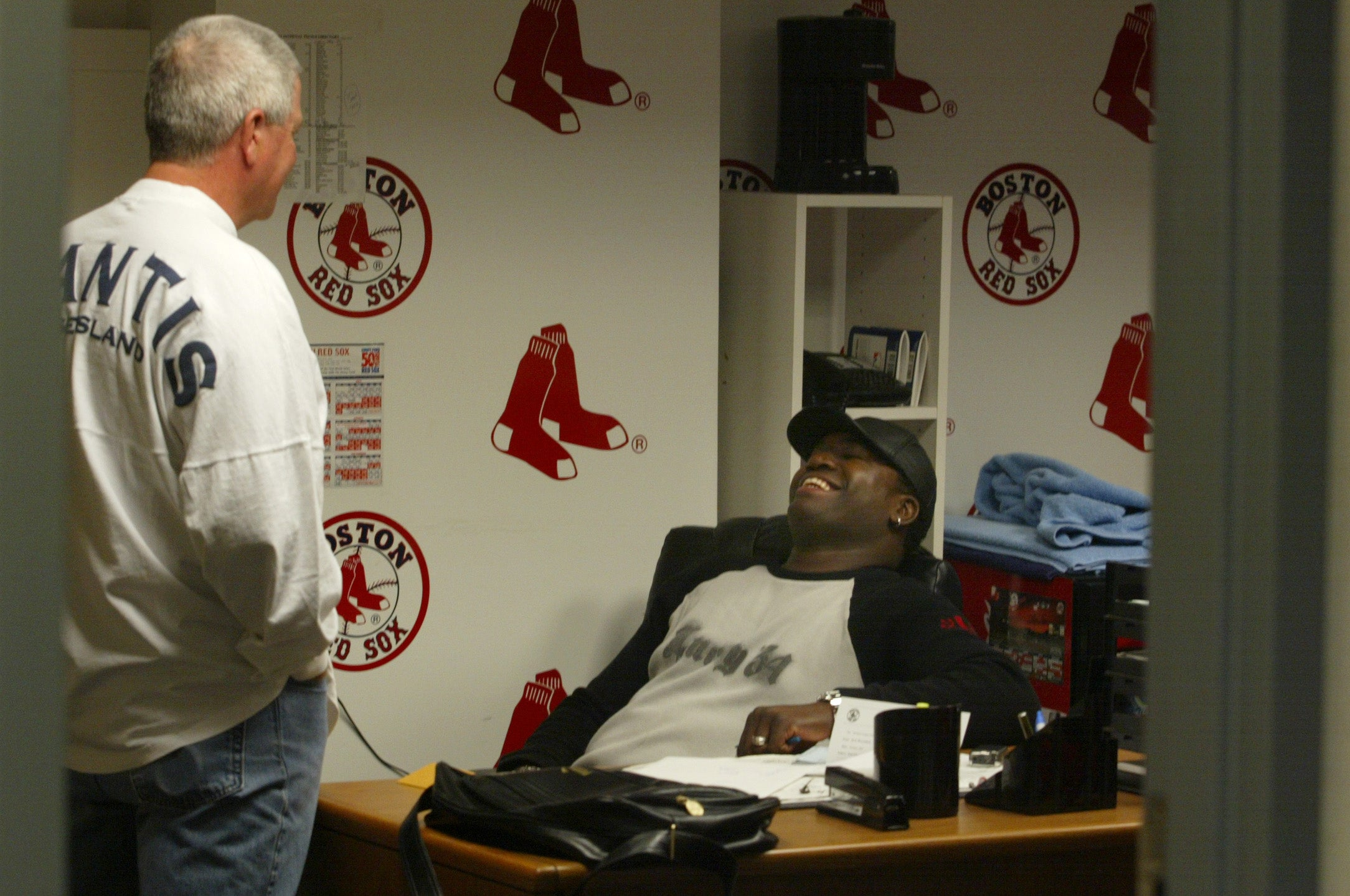 Red Sox manager Grady Little enters his office to find David Ortiz in his chair in the Red Sox clubhouse following the loss to the Yankees in Game 7 of the 2003 ALCS.