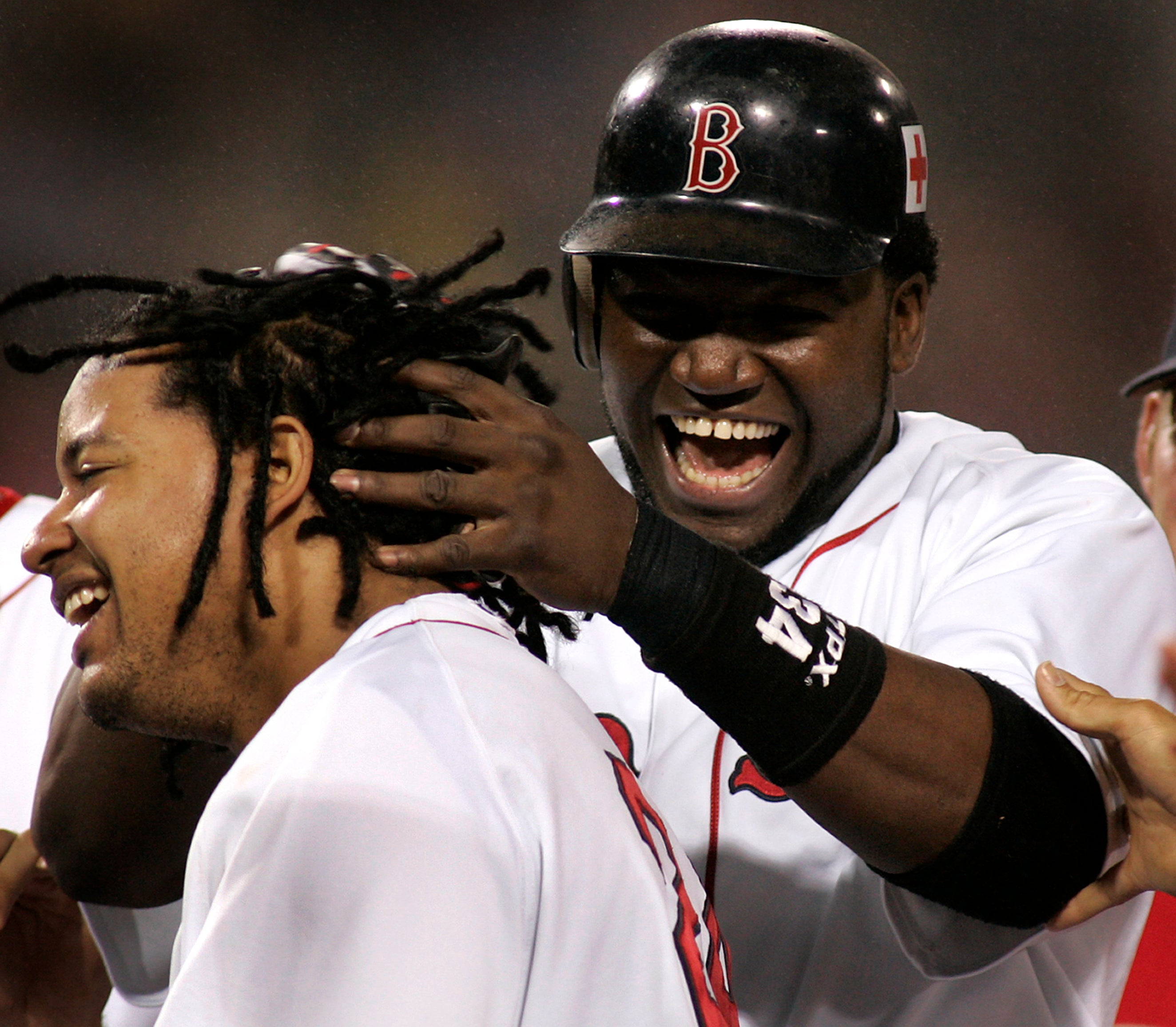 David Ortiz shares a moment with former teammate Manny Ramirez.