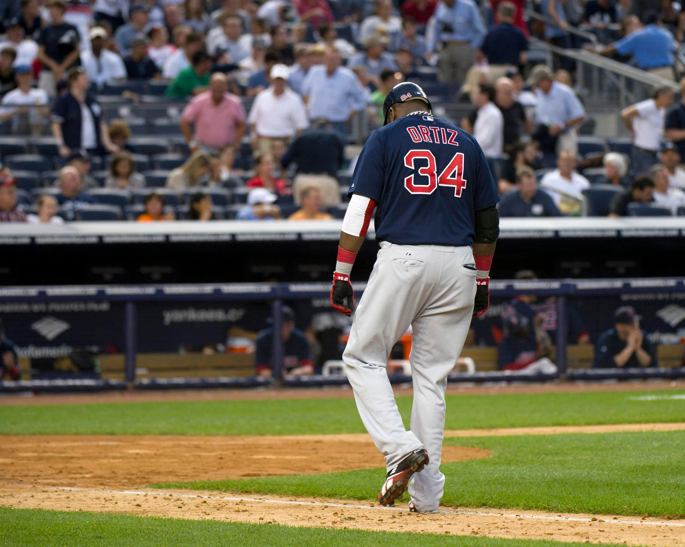 Boston Red Sox batter David Ortiz walks back to the dugout after grounding out against the New York Yankees.