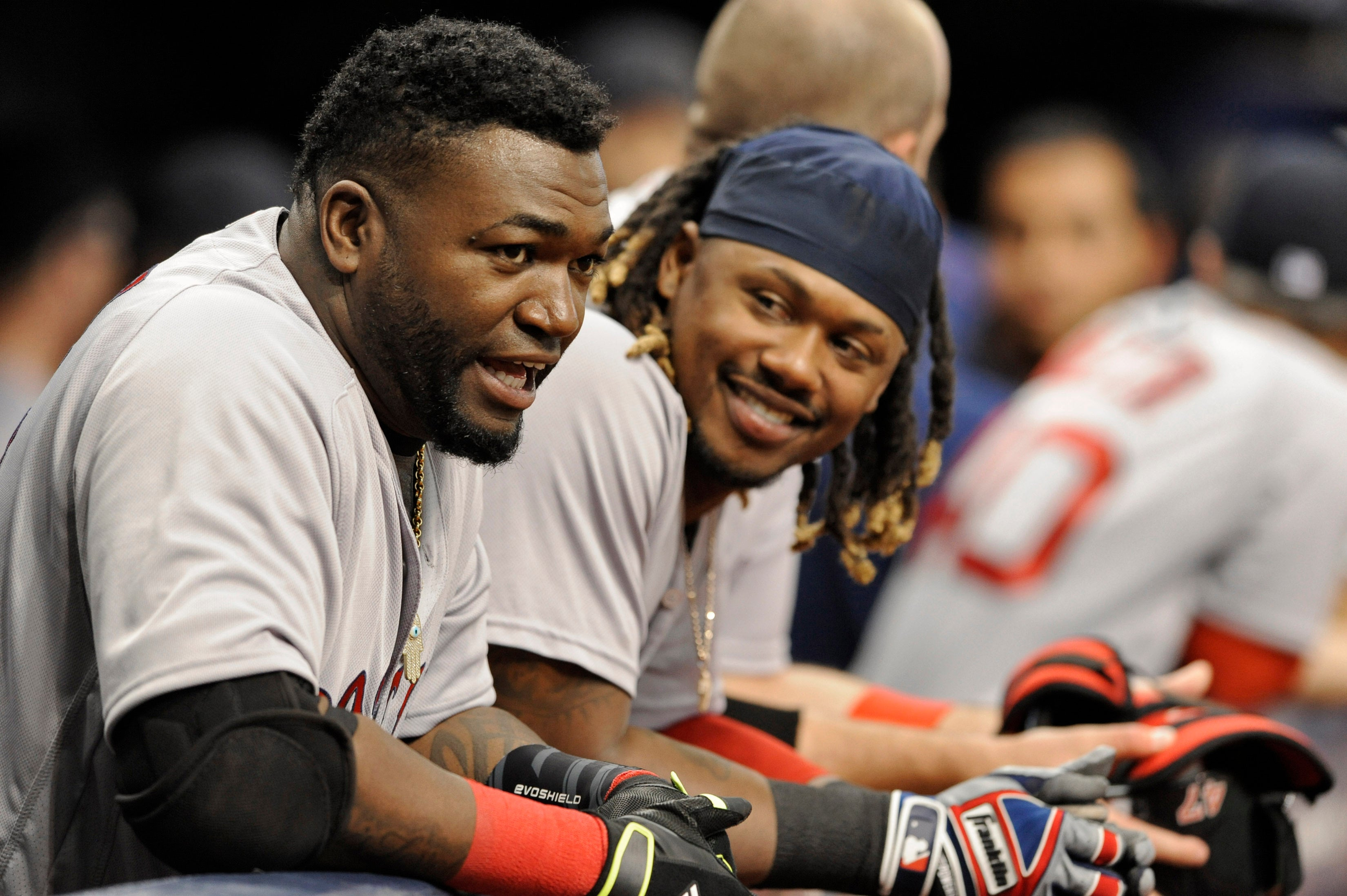 David Ortiz, left, and Hanley Ramirez talk in the Red Sox dugout during a game against the Rays.