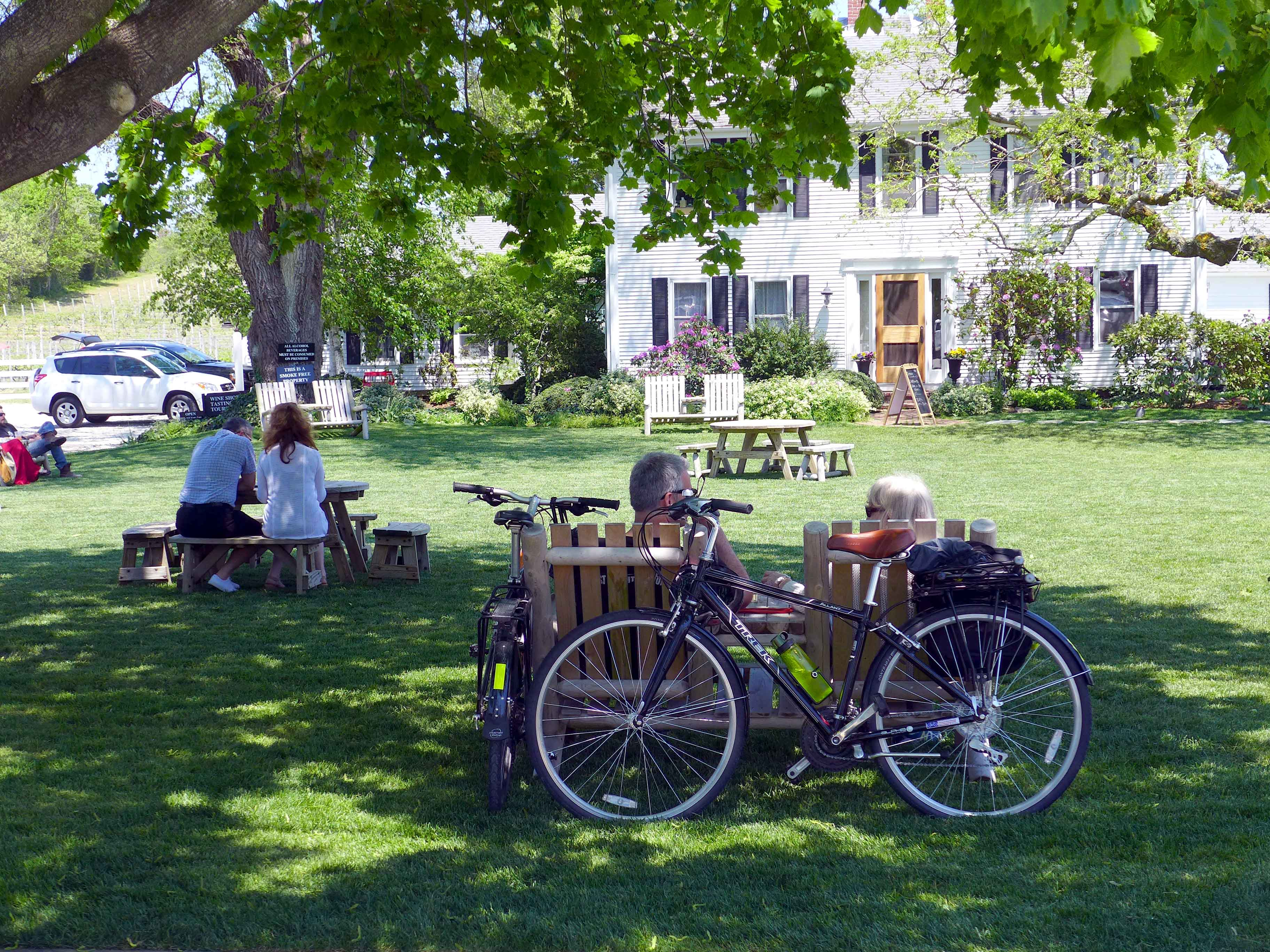 Visitors enjoy relaxing on a sunny afternoon on the lawns of Truro Vineyards.