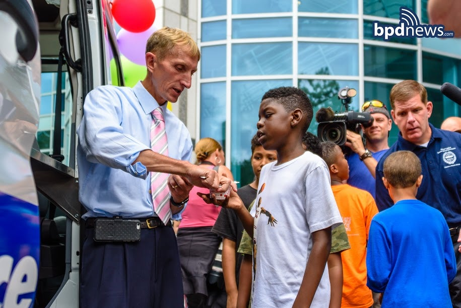 Commissioner Evans handing out Hoodsie Cups.