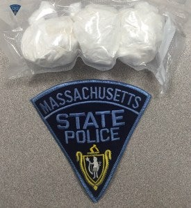 Two people were stopped on I-84 Sunday and charged with cocaine trafficking, according to Mass. State Police.