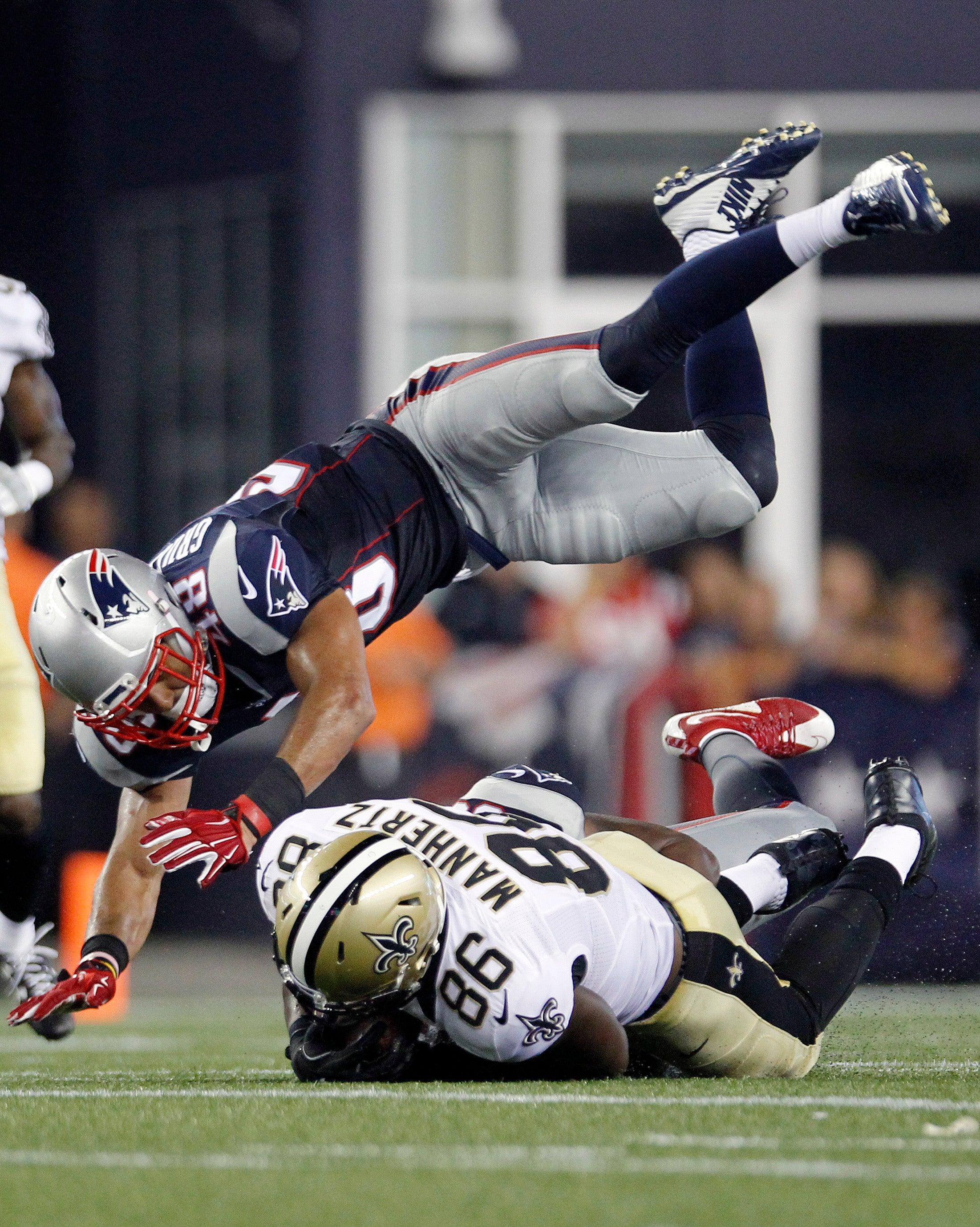 Kamu Grugier-Hill soars over Saints tight end Chris Manhertz during the Patriots' preseason win over the Saints.