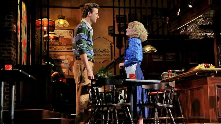 Grayson Powell as Sam and Jillian Louis as Diane in 'Cheers Live on Stage.'