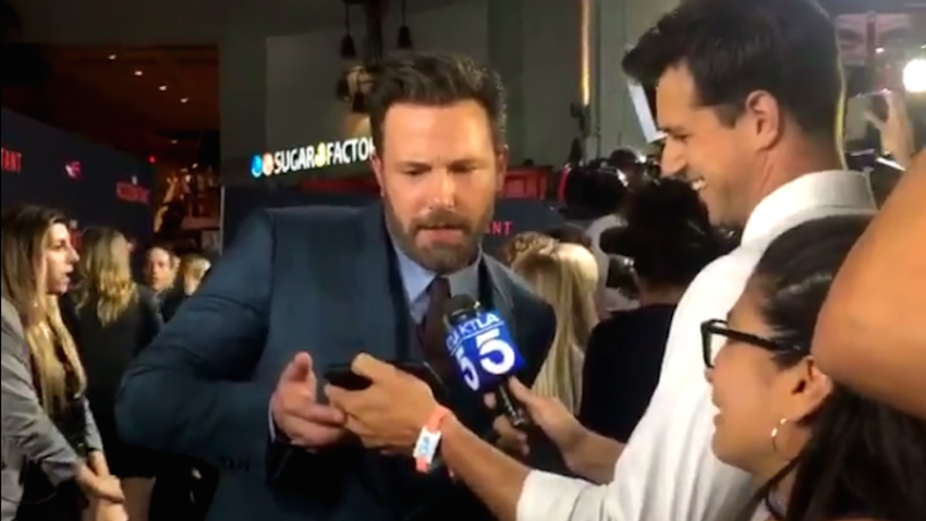 Ben Affleck halted on the red carpet to watch the Red Sox on a reporter's phone