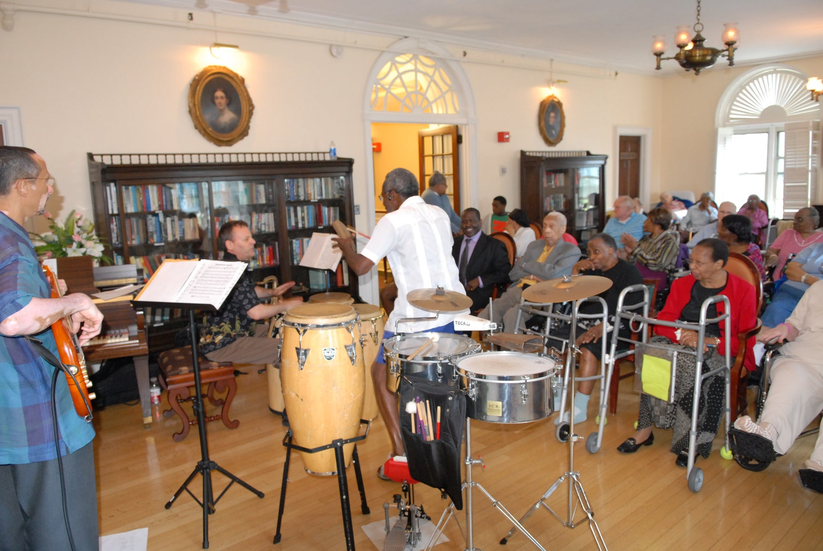 """Cornell Coley conducting his """"Therapeutic Drumming"""" workshop."""