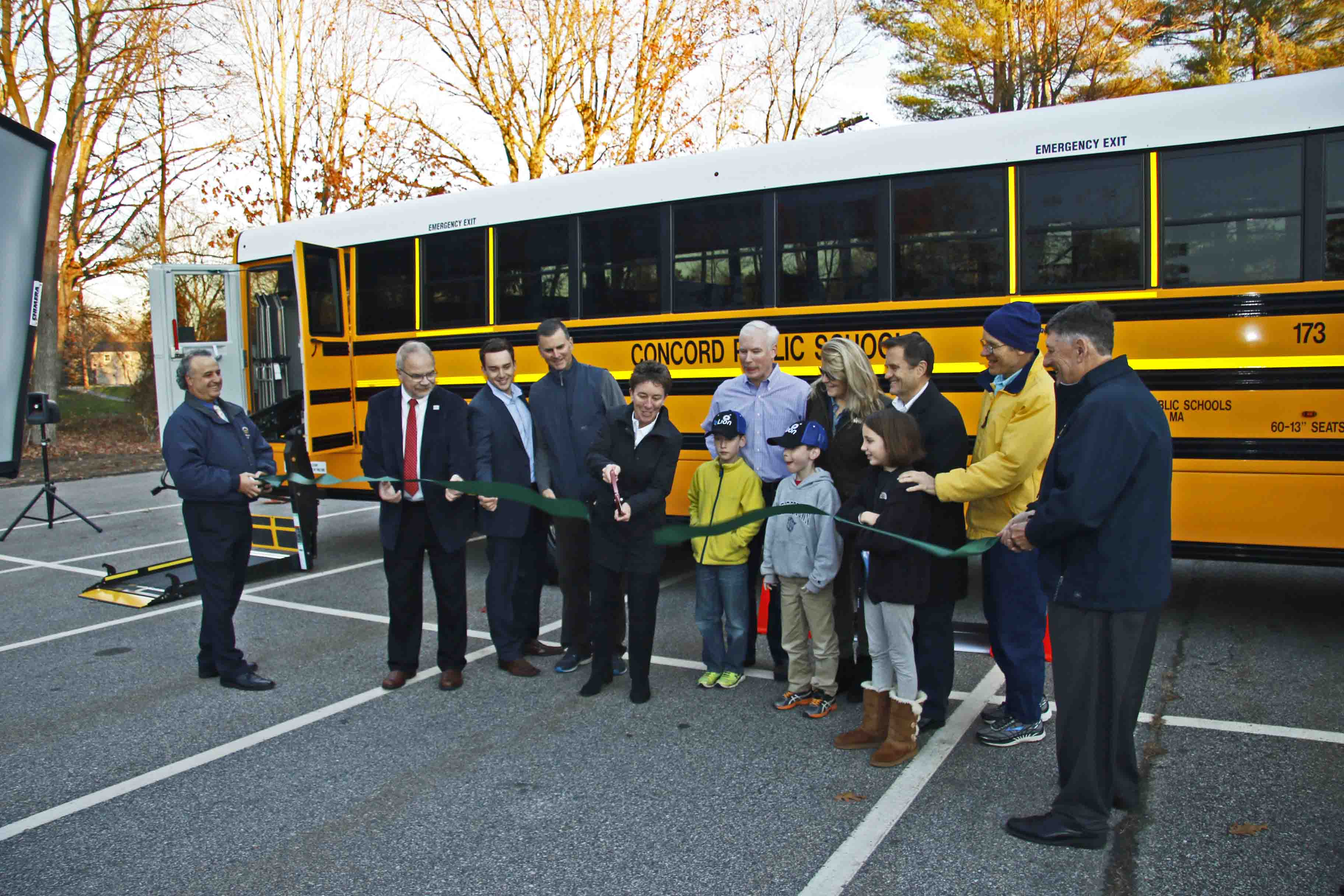 A CELEBRATION: Town leaders, students, and state officials gather to celebrate the state's first all-electric school bus with a ribbon-cutting ceremony.