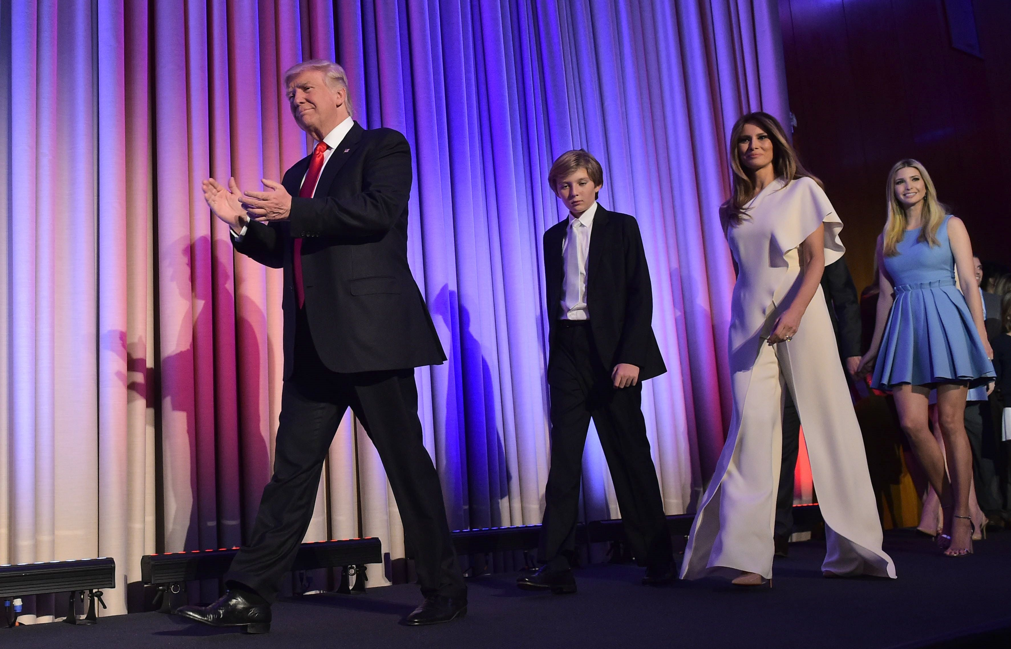 Republican presidential elect Donald Trump arrives with his family on stage to speak during election night at the New York Hilton Midtown in New York on November 9, 2016.  Trump stunned America and the world Wednesday, riding a wave of populist resentment to defeat Hillary Clinton in the race to become the 45th president of the United States. / AFP PHOTO / MANDEL NGANMANDEL NGAN/AFP/Getty Images