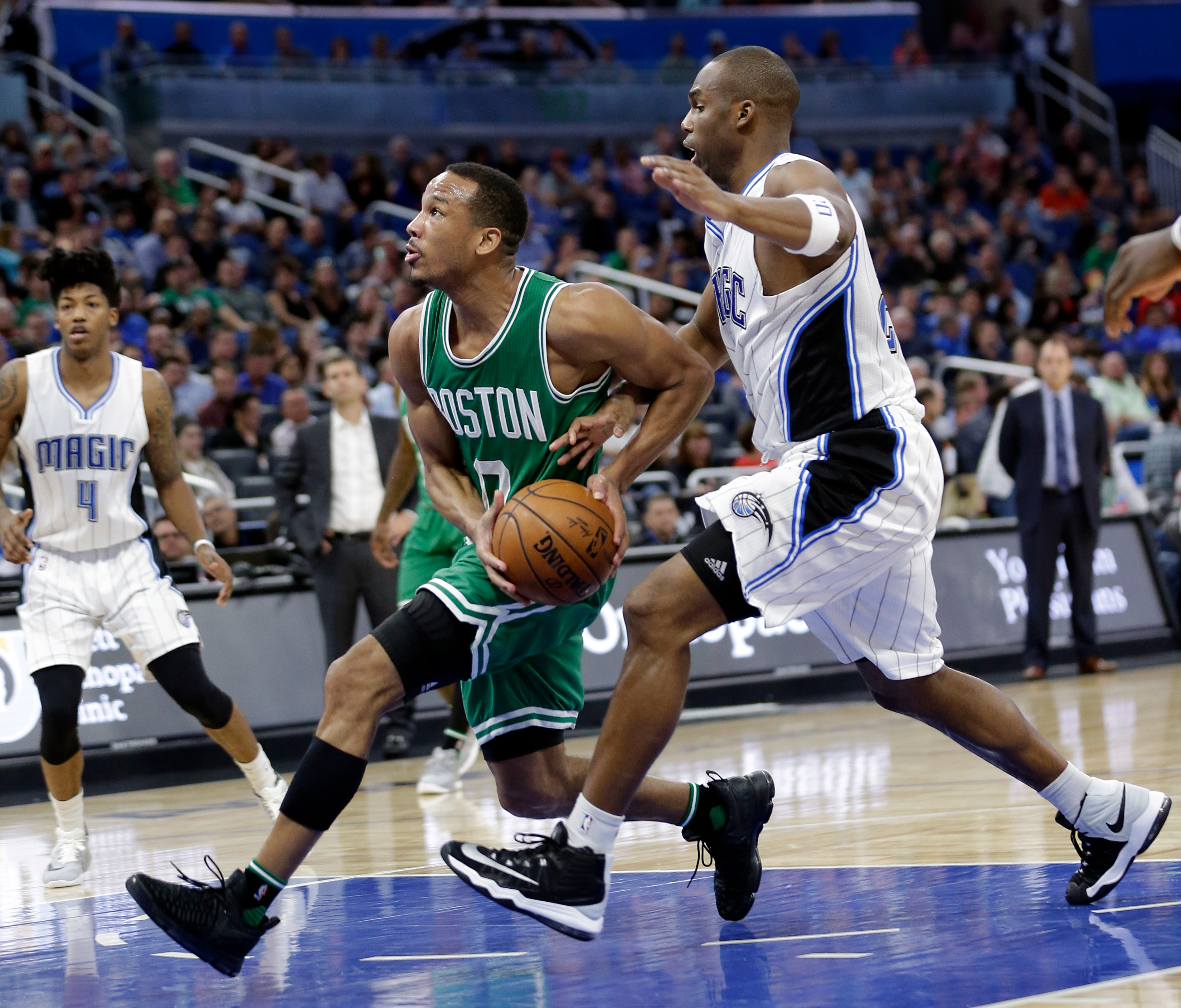 Boston Celtics' Avery Bradley, left, goes past Orlando Magic's Jodie Meeks on a drive to the basket during the second half of an NBA basketball game, Wednesday, Dec. 7, 2016, in Orlando, Fla. Boston won 117-87. (AP Photo/John Raoux)