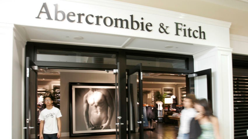 FILE- In this Aug. 12, 2008 file photo, shoppers walk in front of a Abercrombie & Fitch store in San Jose, Calif. Sales fell more than expected in September and October as fewer people headed to the mall and shoppers shunned clothing with the retailer's logo on it. It also reported weaker sales at its European stores, especially at its Hollister brand. Abercrombie's stock fell as much as 14 percent Friday, Nov. 7, 2014, reaching a two-year low. (AP Photo/Paul Sakuma, file)