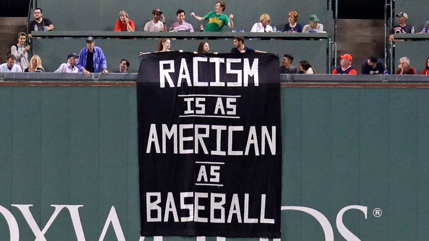 Fans drape 'Racism is as American as baseball' sign over Green Monster
