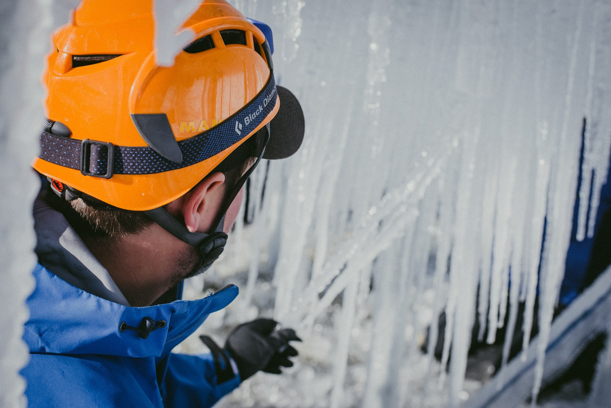 An ice artisan harvests icicles.
