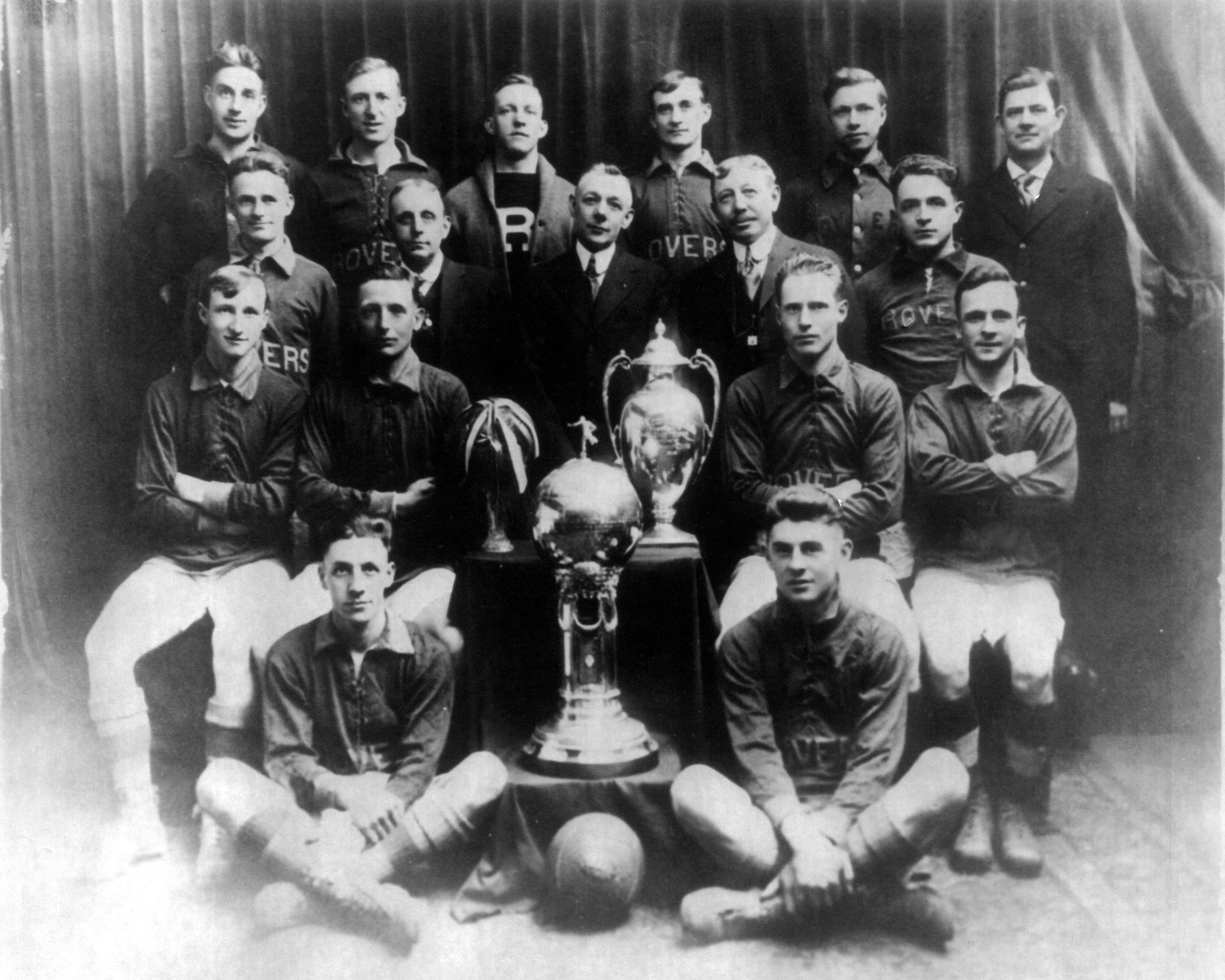 The Fall River Rovers in 1917 posing with the National Challenge Cup and Times Cup.