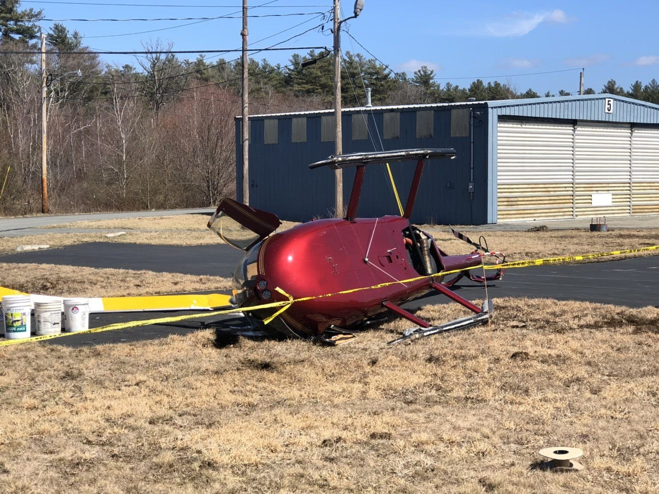 Helicopter with 2 aboard crashes at Mass  airport | Boston com