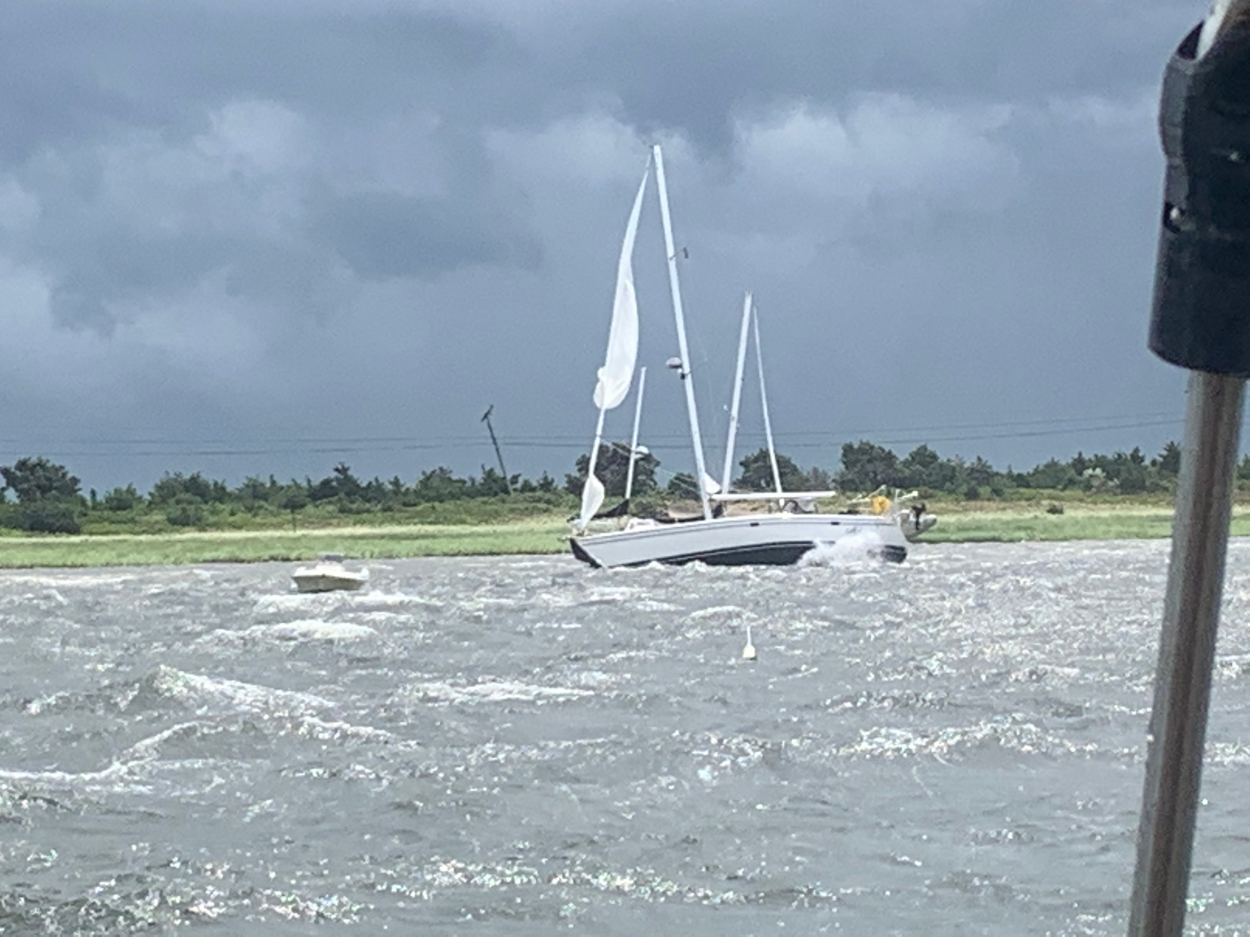 Video: Man survives wild ride on sailboat during tornado on
