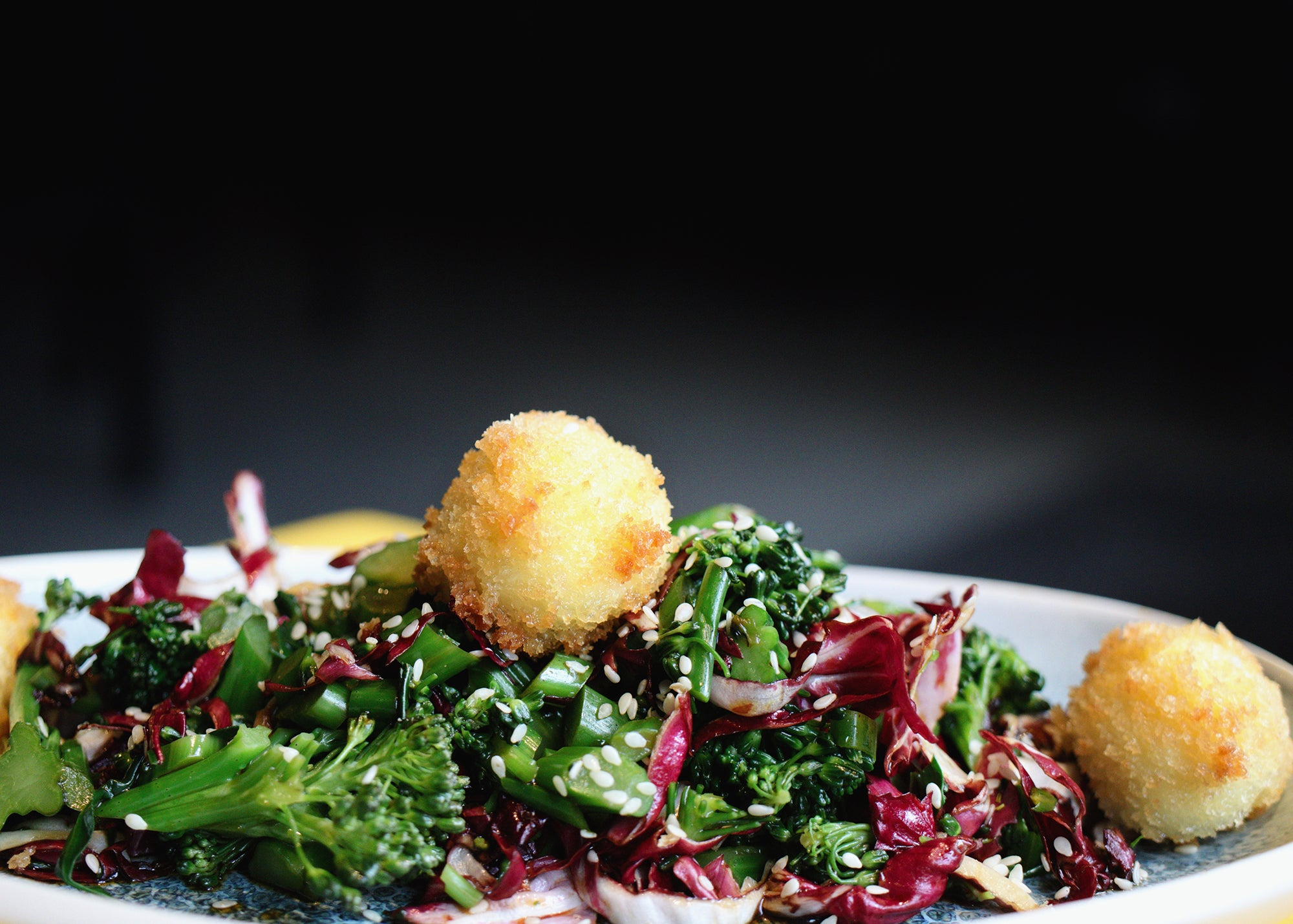 Broccoli slaw and goat cheese fritters at Pollo Club