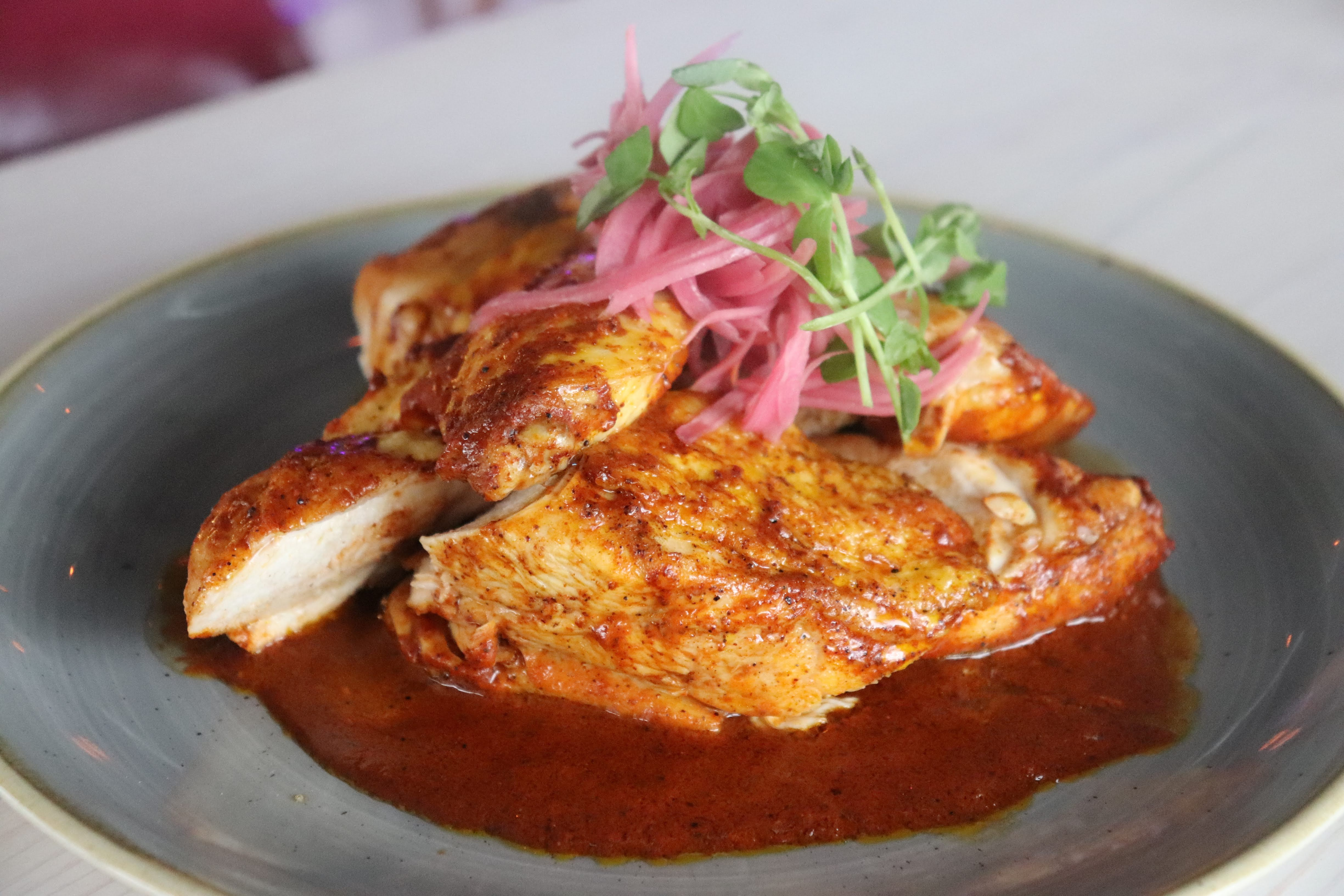 Pollo al horno, roasted chicken in adobo sauce, at Ghost Pepper