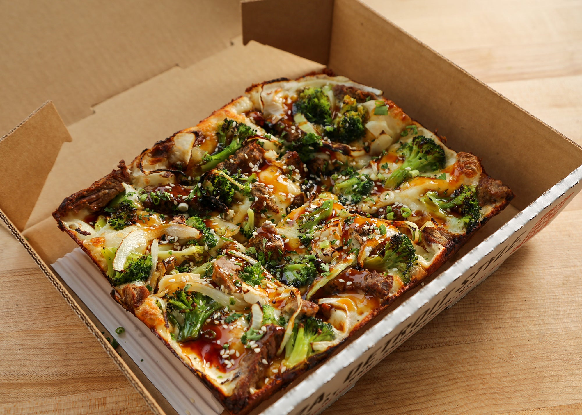 Beef and broccoli pizza at Square Mfg. Co.