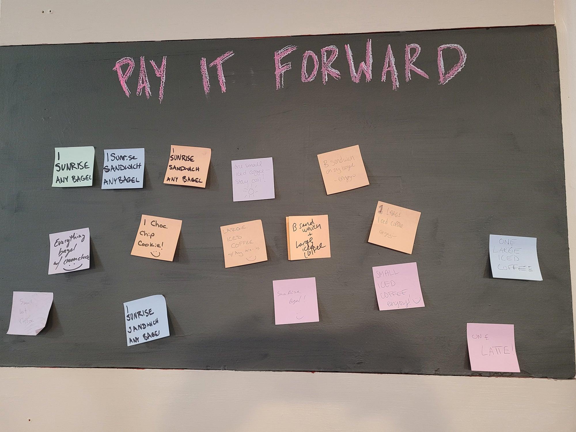Pay It Forward wall at Ula Cafe
